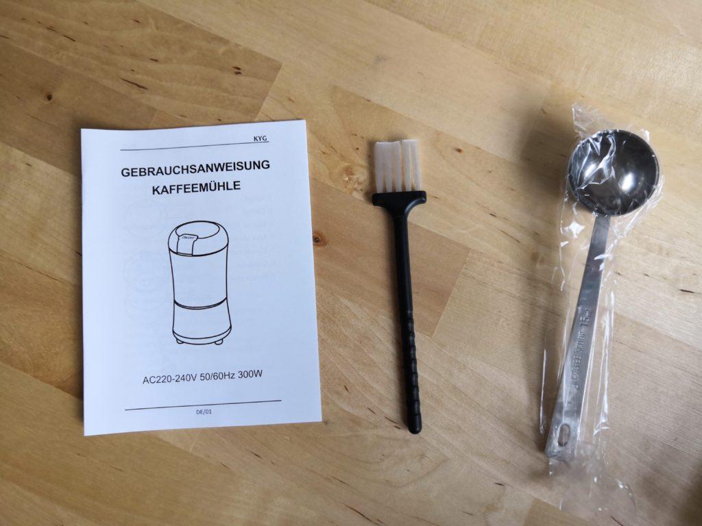 Packungsbeilage KYG  Gebrauchsanweisung, Dosierlöffel und Reinigungspinsel